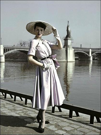 """DIOR'S """"NEW LOOK"""" AND LA STATUE DE LA LIBERTÉ, BY COMBAT PHOTOGRAPHER ROBERT CAPA, PARIS, 1948"""