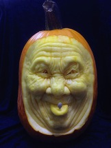 A funny face carved out of a pumpkin