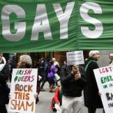 Protestors demonstrate advocating for the inclusion of gay marchers in the 254th New York City St. Patrick's Day parade as parade marchers make their way up 5th Avenue in the Manhattan Borough of New York, March 17, 2015. REUTERS/Mike Segar